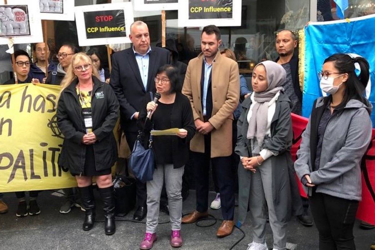Fenella Sung of Canadian Friends of Hong Kong speaks to a protest rally outside the Union of B.C. Municipalities convention, Vancouver, Sept. 25, 2019. Behind her is Port Coquitlam Mayor Brad West (brown coat) and Coun. Steve Darling. (Katya Slepian/Black Press)