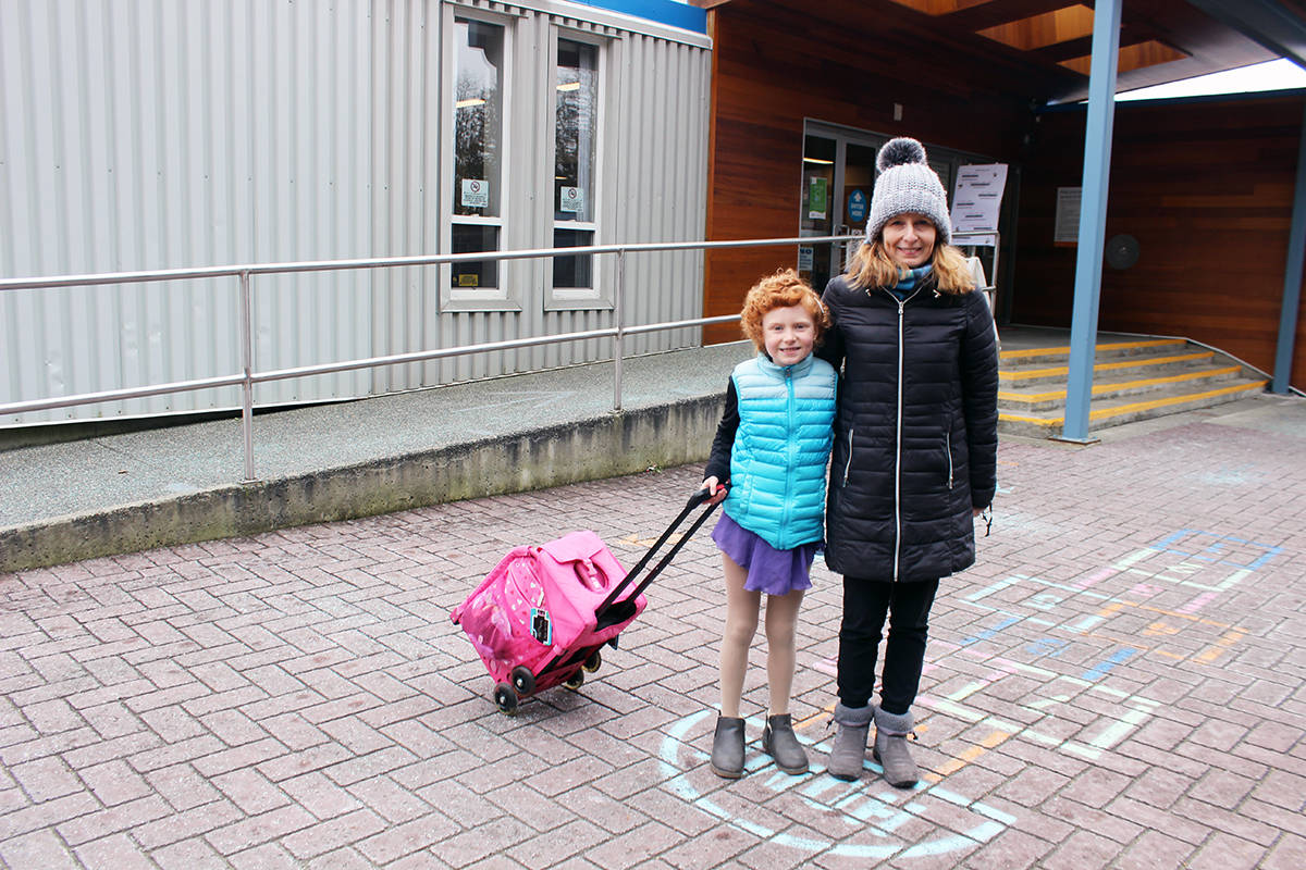 Ella Donovan with mom Tina outside Fuller Lake Arena before heading onto the ice for practice. (Photo by Don Bodger)